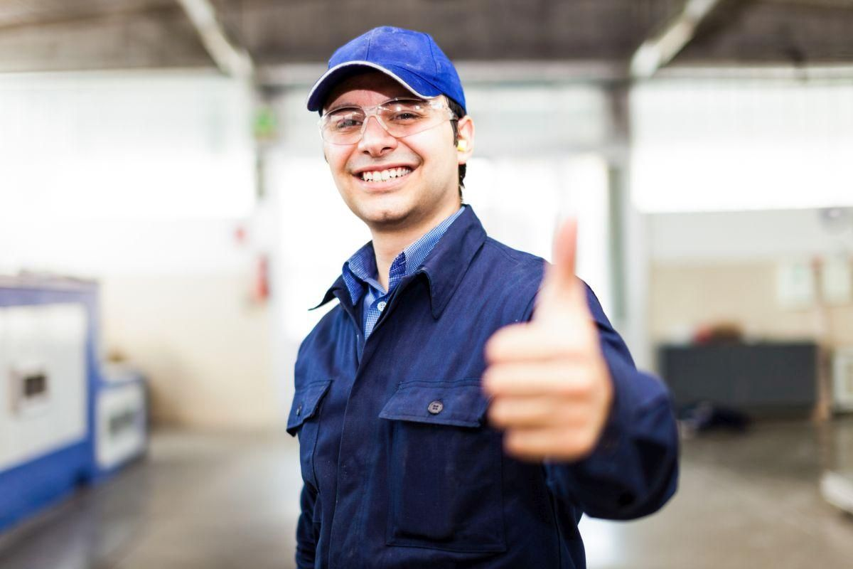Portrait of a smiling worker in a factory