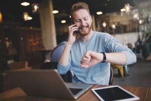 Occupied businessman multitasking in cafe