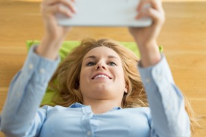 Woman using tablet in the morning