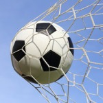 Soccer foot ball in goal net
