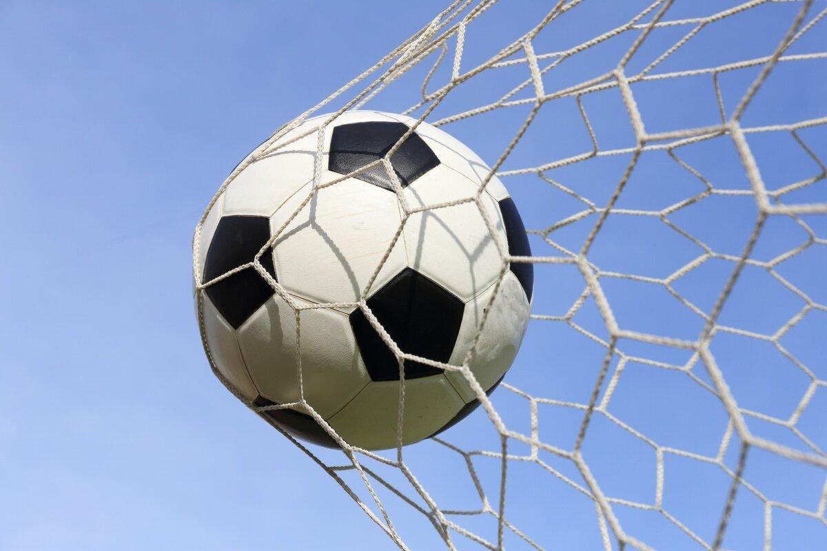Soccer foot ball in goal net